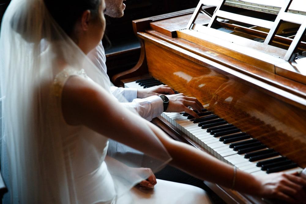 Playing the piano at Crewe Hall wedding