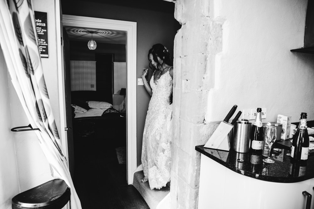 bride preparing for her park house barn wedding