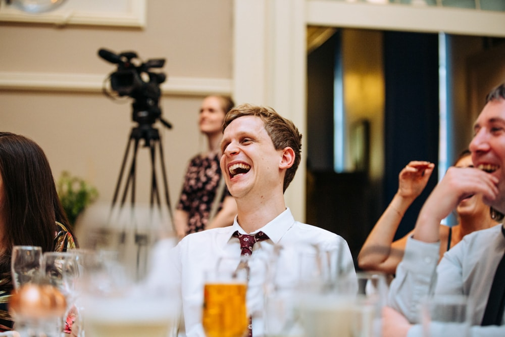 A guest laughing during the ceremony