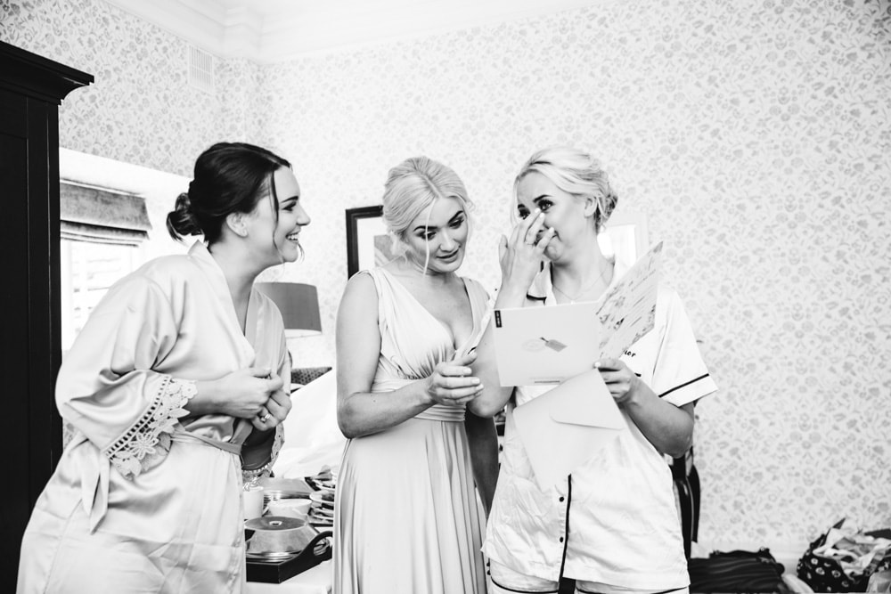 bride getting ready at mottram hall with her bridesmaids