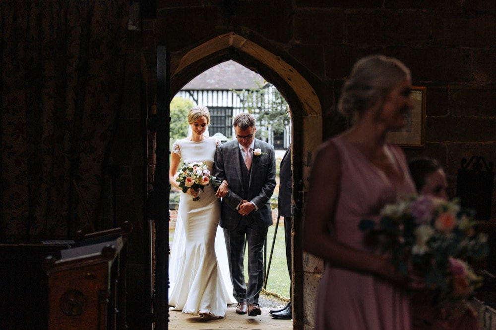 bride walking down the aisle in a cheshire church