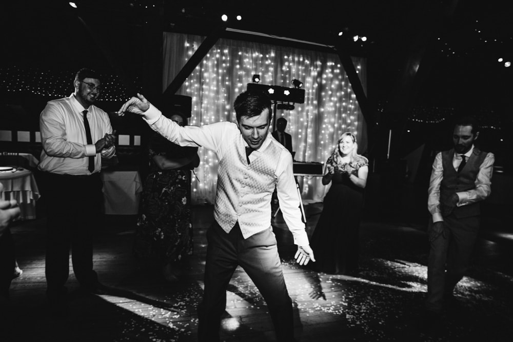 groom dancing at rivington barn with friends