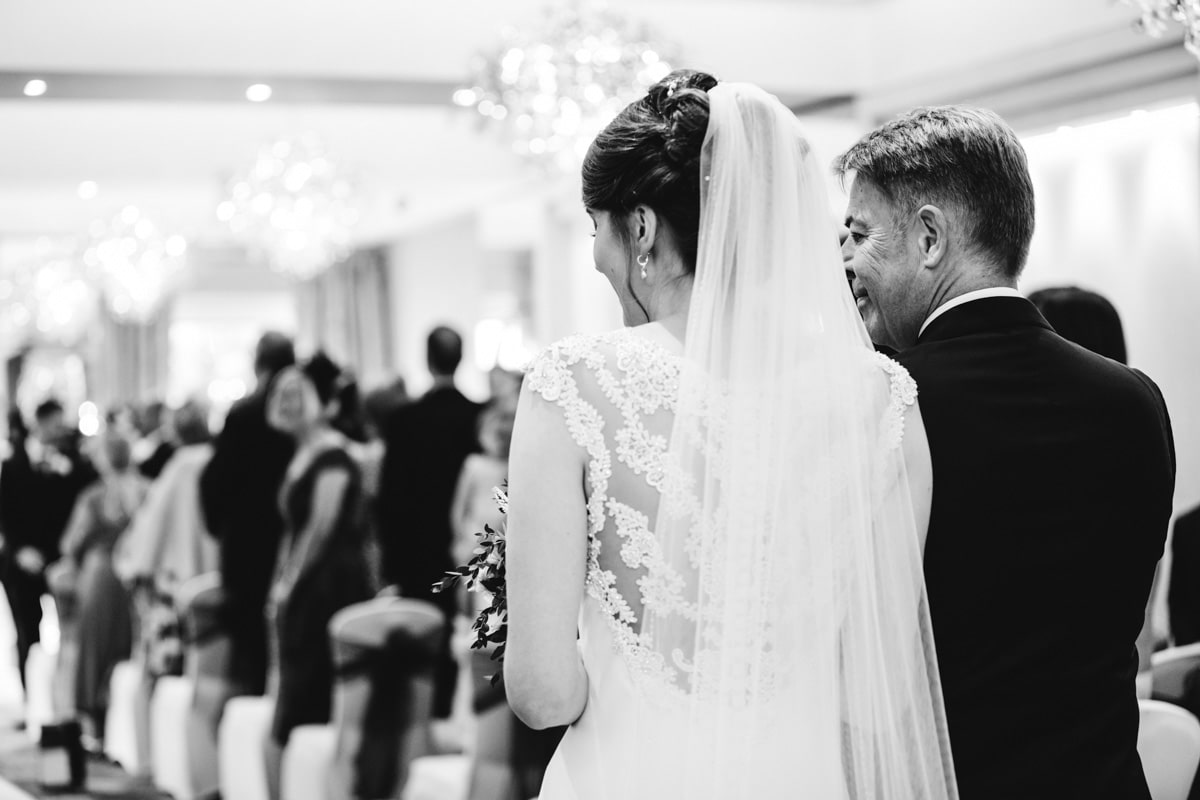 bride and her dad walking down the aisle at thornton hall hotel