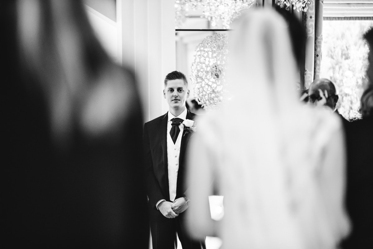 groom seeing the bride for the first time at thornton hall hotel