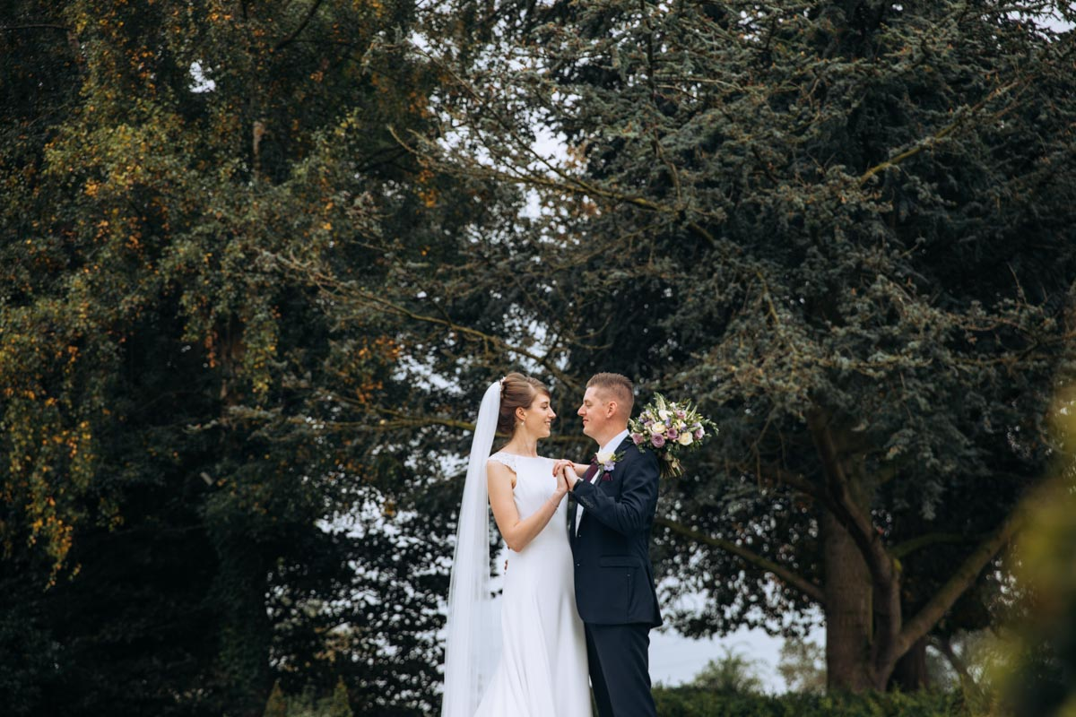 bride and groom in gardens at thornton hall hotel