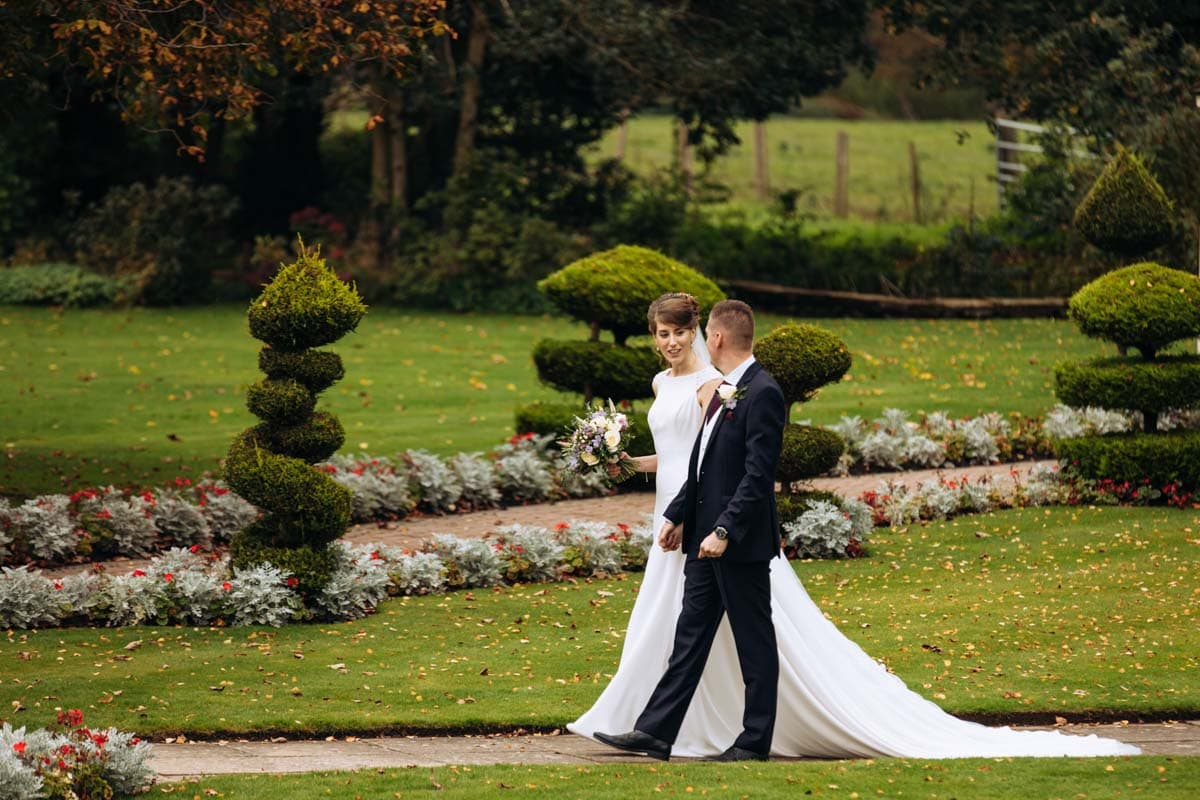 bride and groom walking at thornton hall hotel