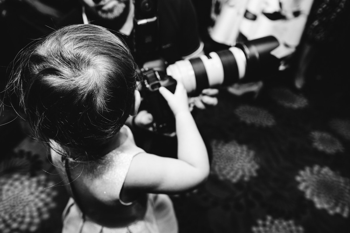 wedding guest with a camera