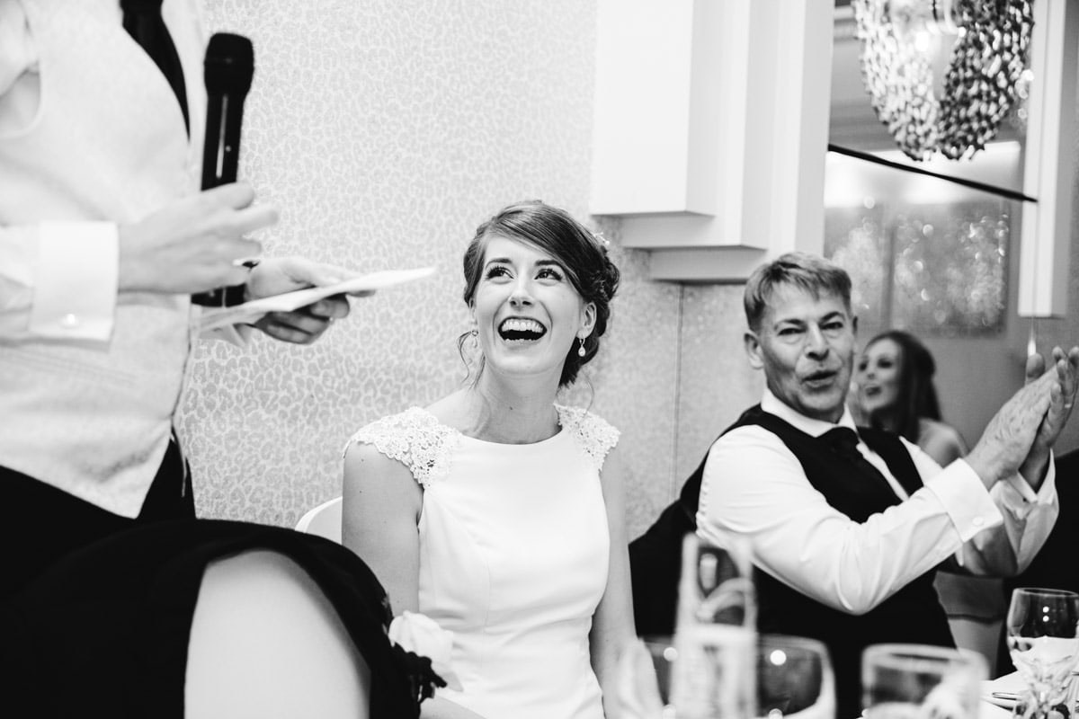 bride giggles during speeches