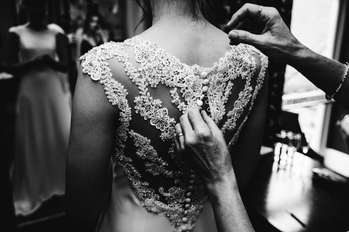 bride getting in wedding dress at thornton hall hotel