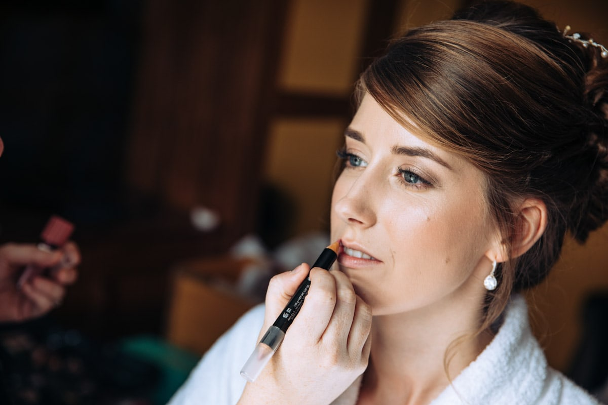 bride getting on makeup at thornton hall hotel