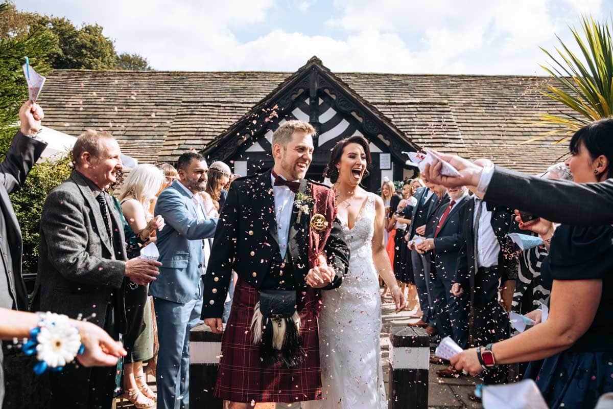 Rivington Barn Wedding Confetti Bride and Groom