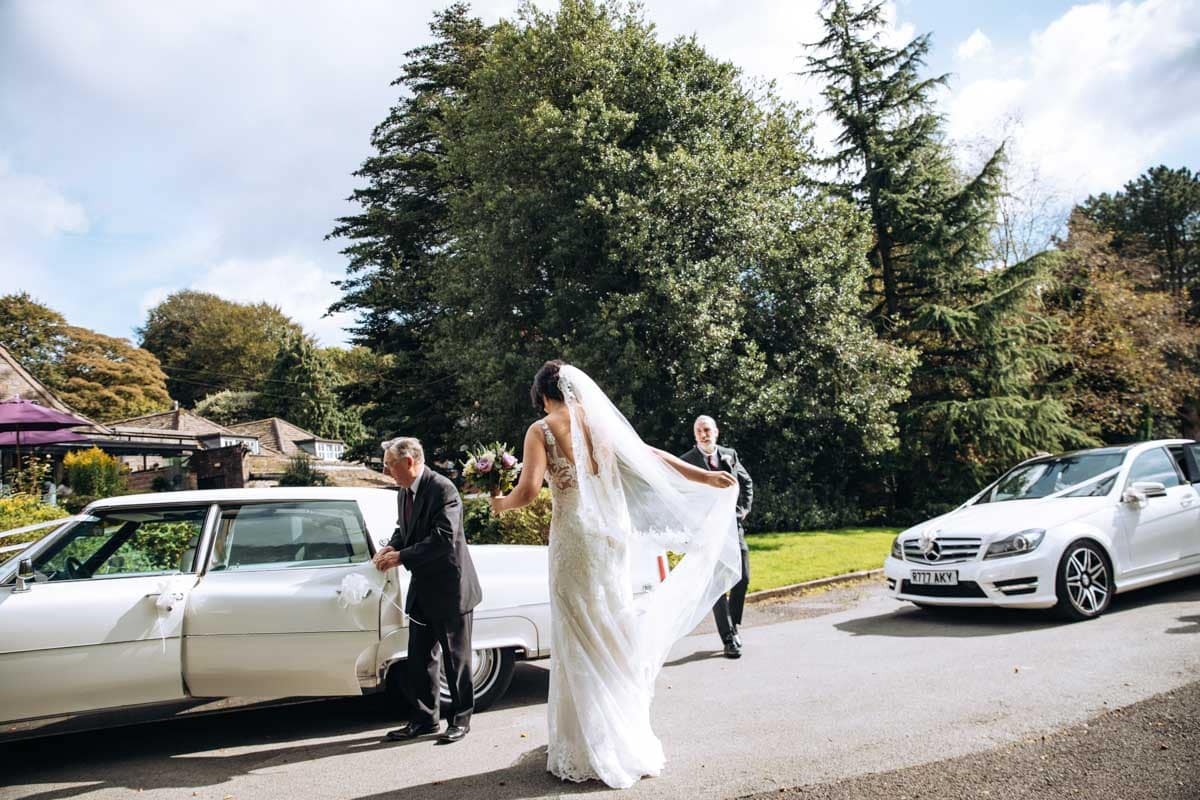 bride arriving at rivington barn in bolton