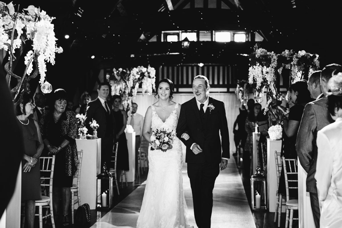 walking down the aisle at rivington barn