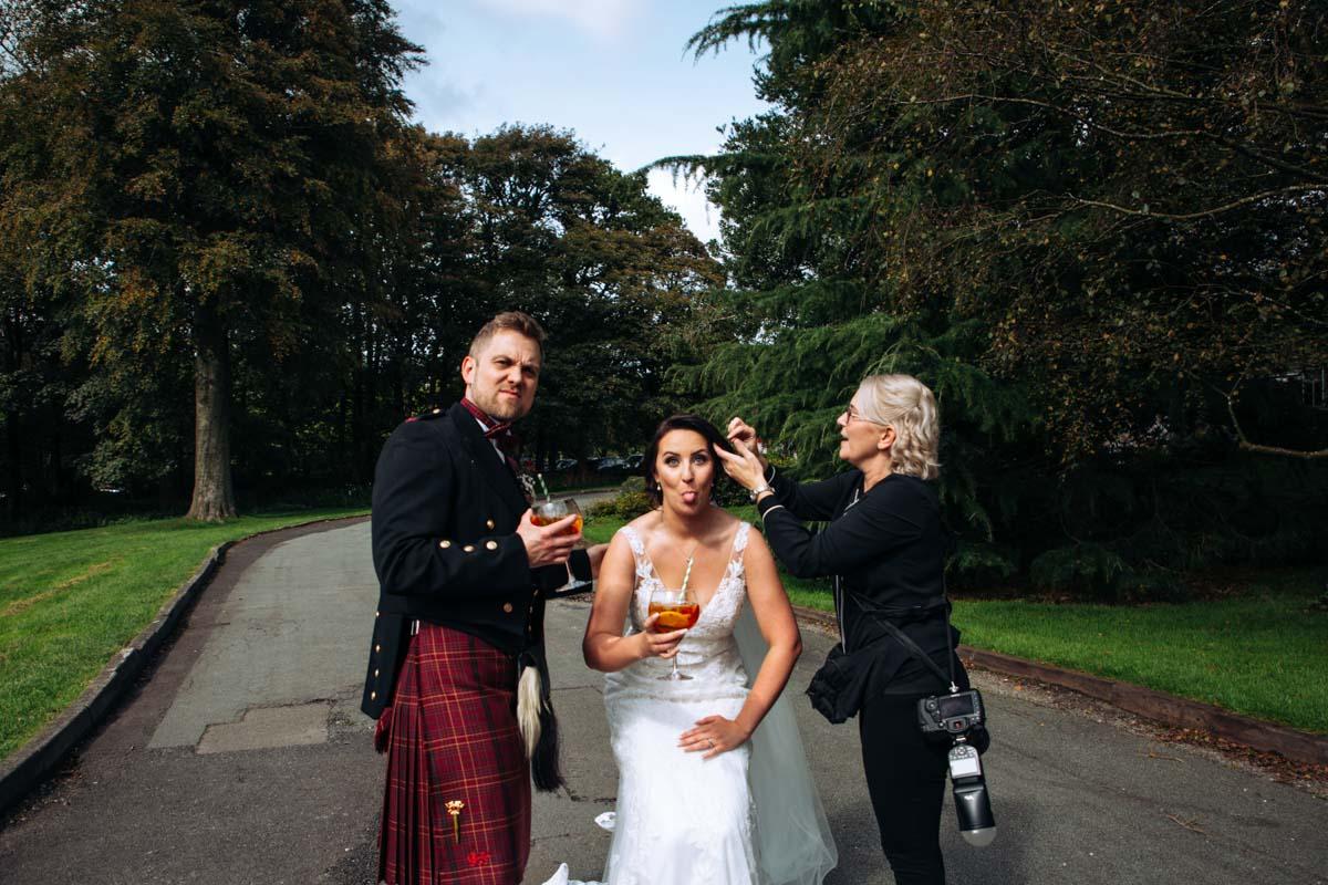 photographer with bride at rivington barn