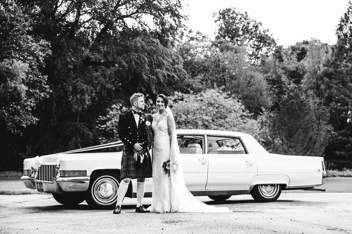 bride and groom with 1970's classic wedding car