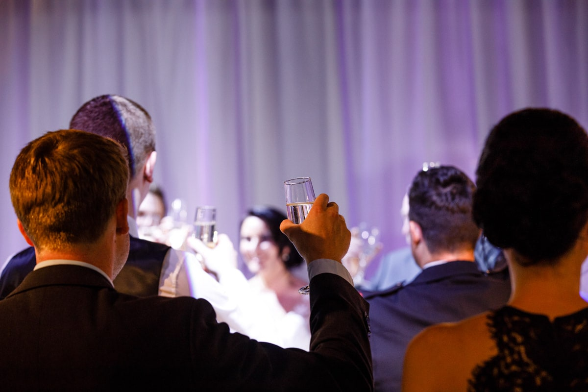 raising a glass at a wedding