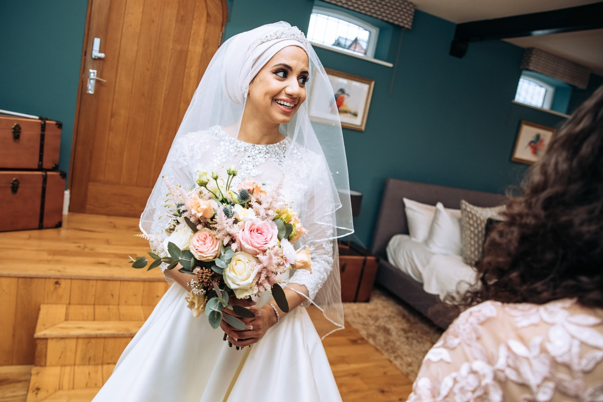 Bride and flowers at Colshaw Hall Wedding