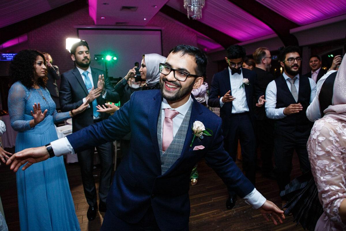 colshaw hall groom enjoying the party
