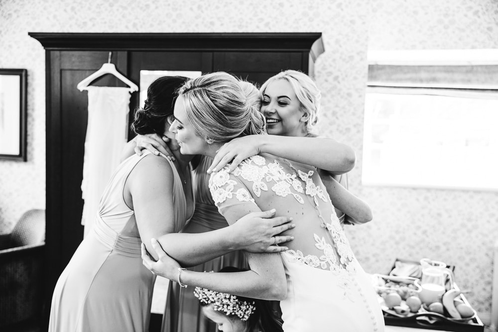 hug from bridesmaids