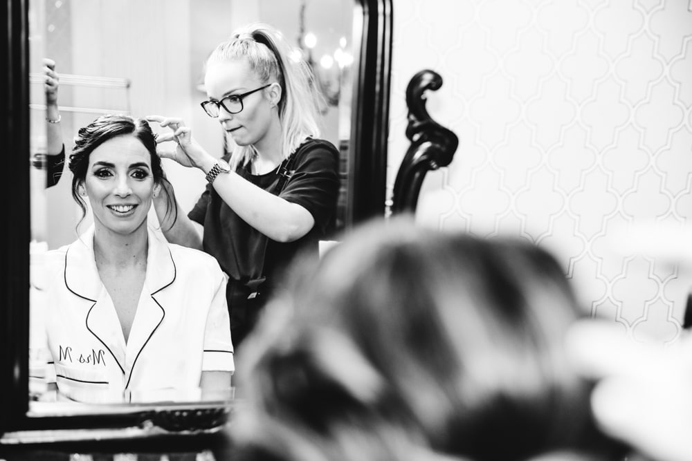 bride getting ready with hair at soughton hall