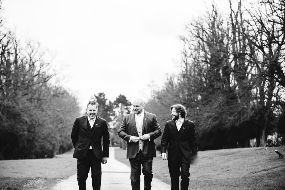 groomsmen at the entrance to soughton hall