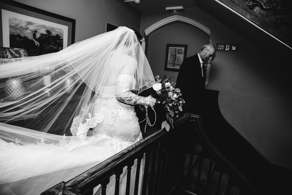 bride on the stairs at soughton hall