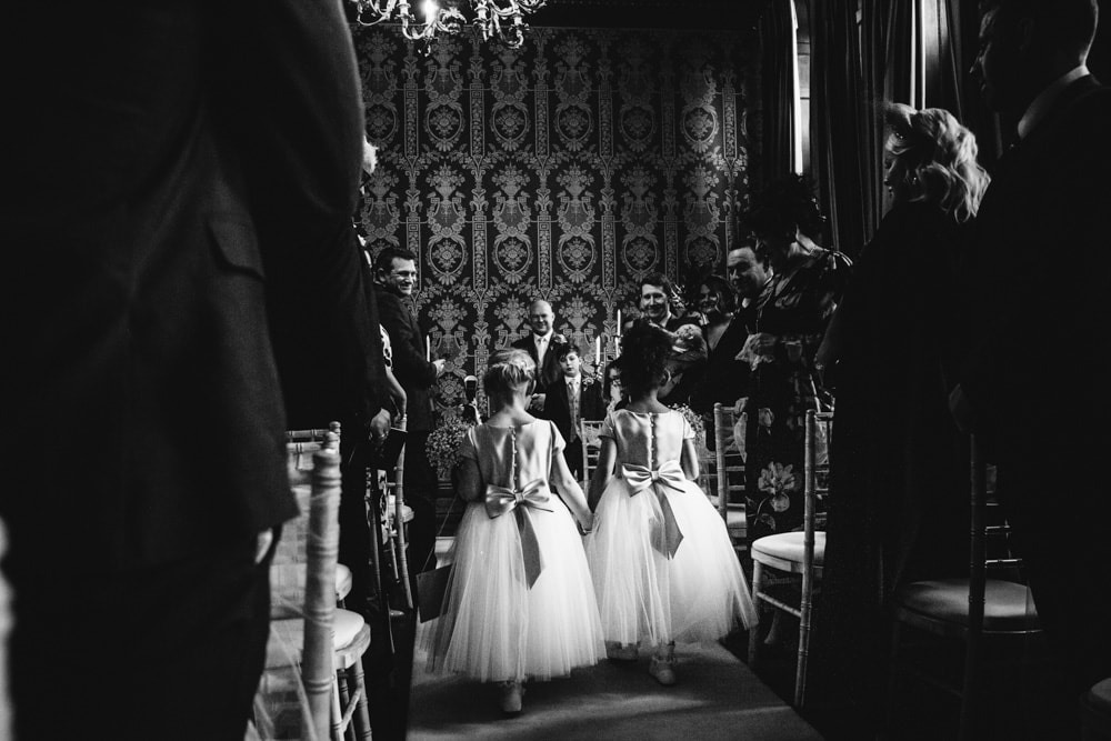 flower girls walking down the aisle at soughton hall