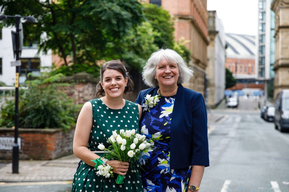 bride and mum outside Heron House Registry Office