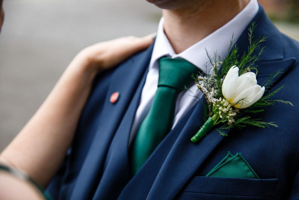 wedding details of grooms flowers