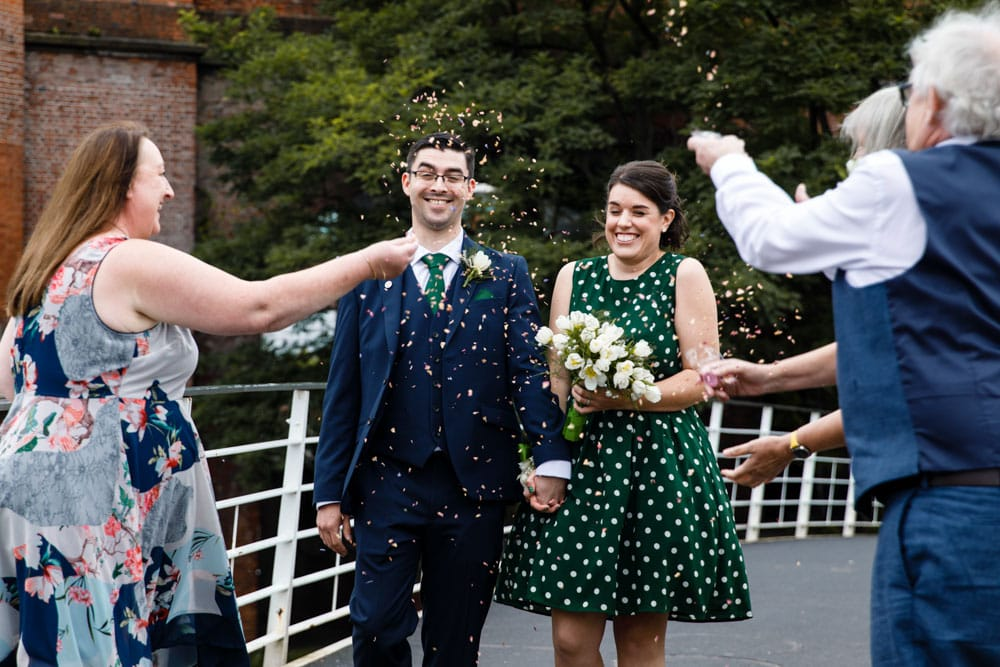 confetti with bride and grooms family in castlefield manchester