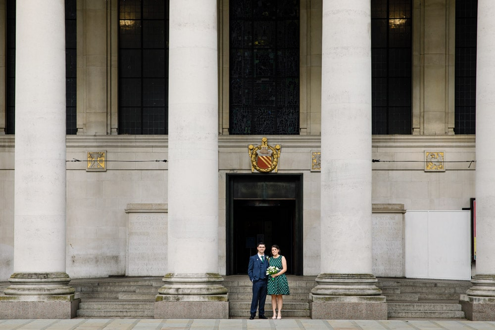 bride and groom outside manchester library