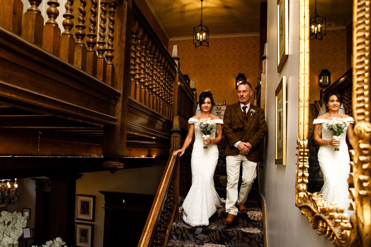 bride walking down stairs at inglewood manor