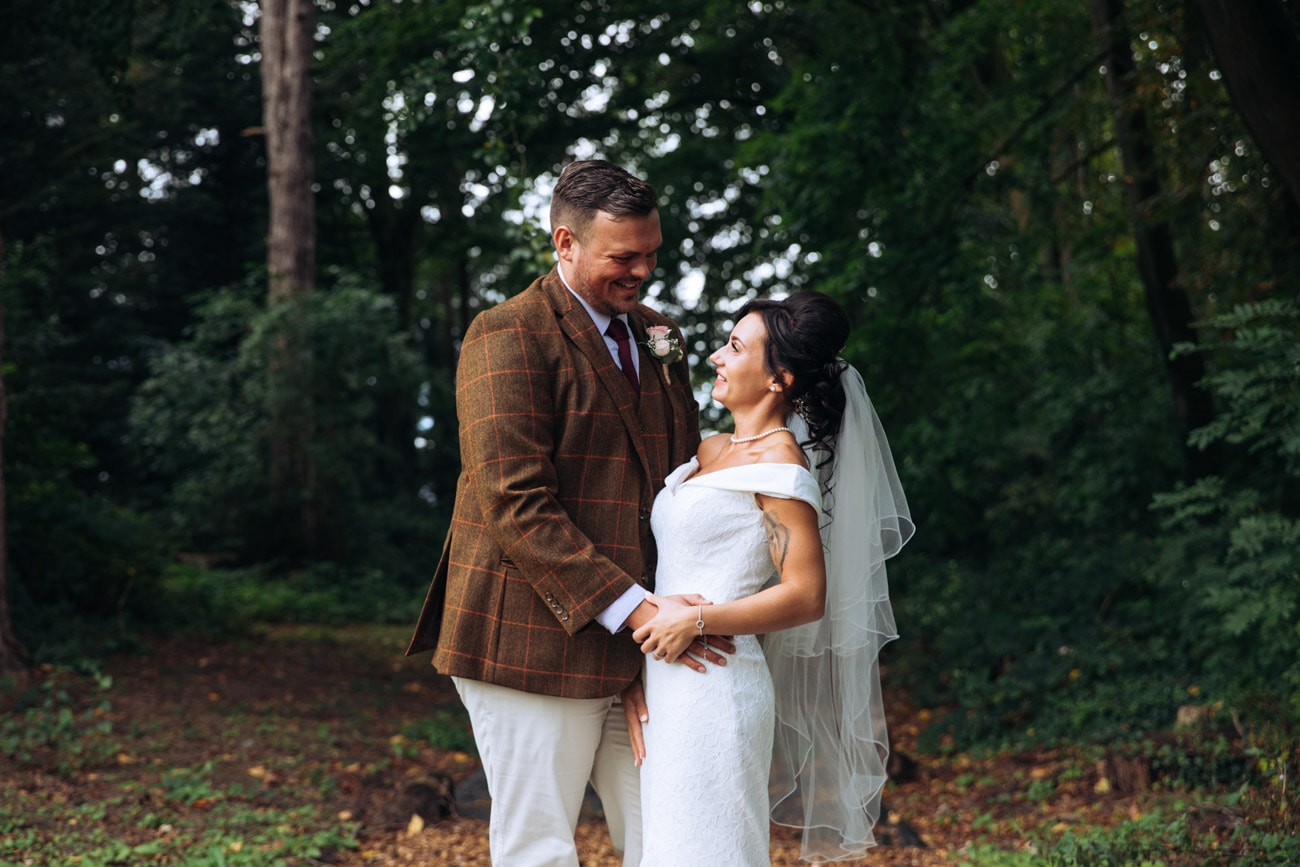 bride and groom in grounds at inglewood manor