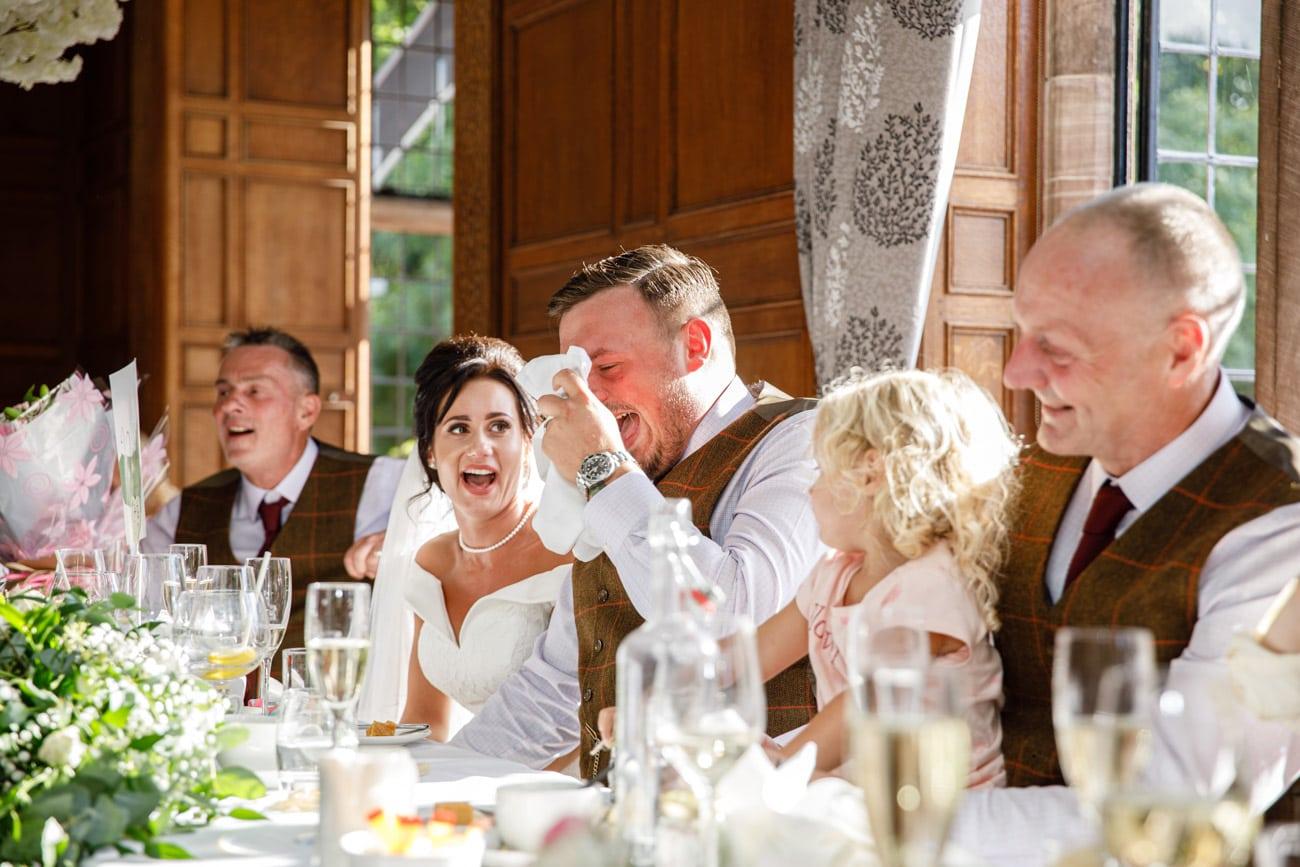 groom laughing during wedding breakfast