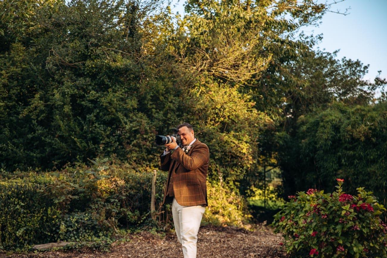 groom taking photo of bride at inglewood manor