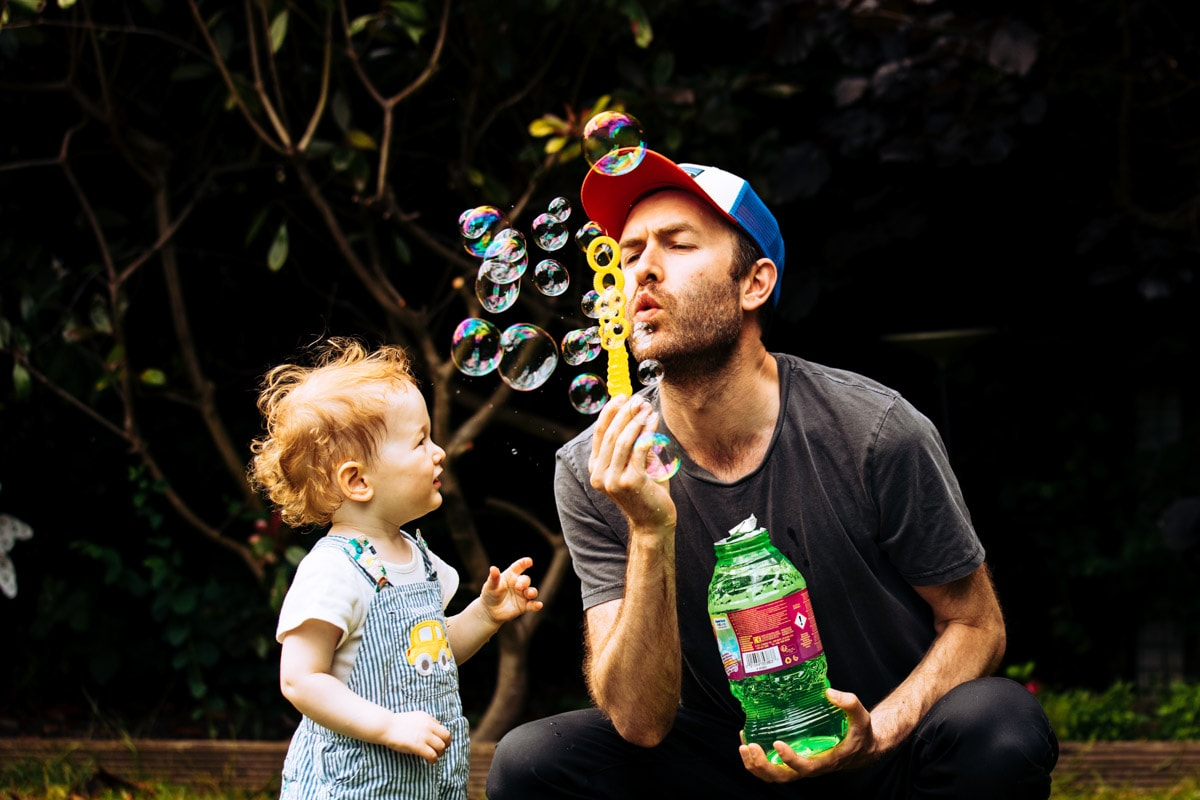 dad blowing bubbles during photoshoot