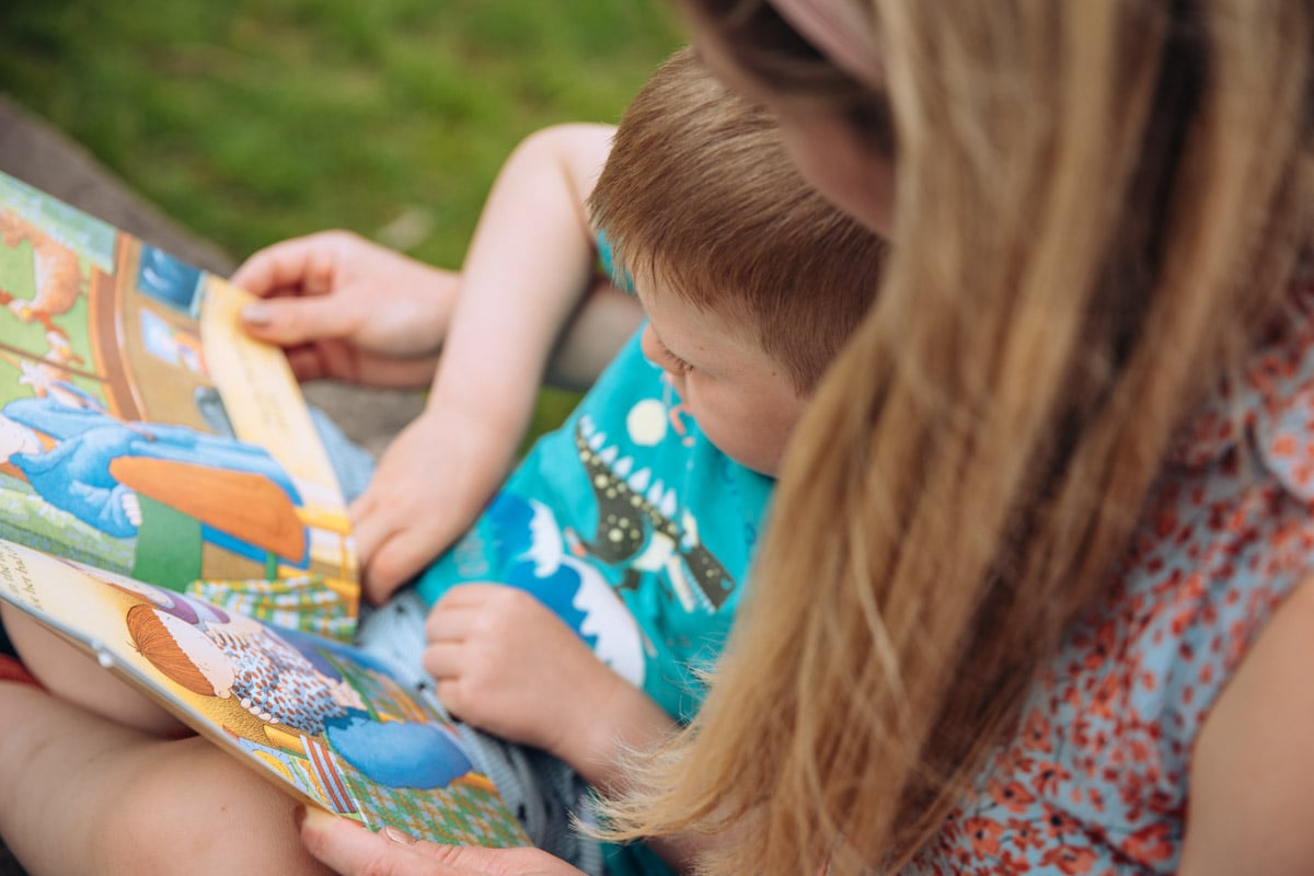 Mum and son reading in a park