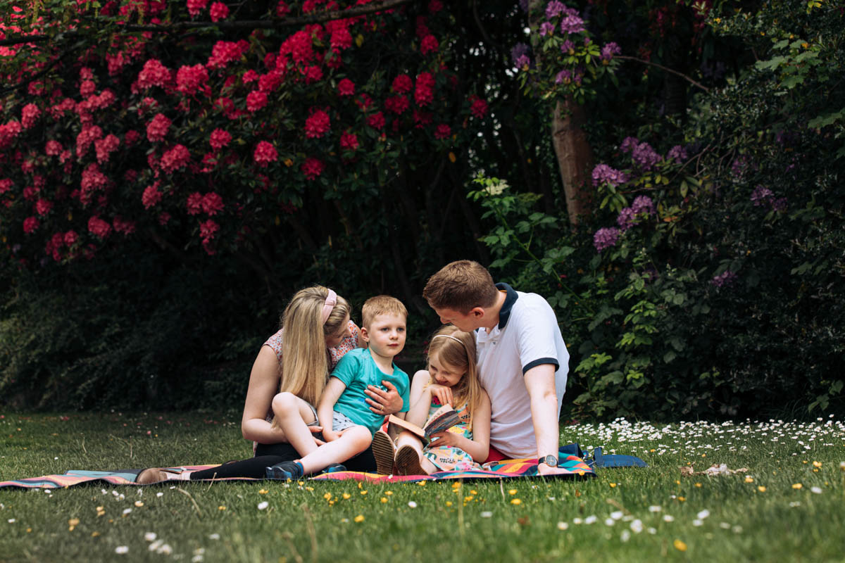 Family reading in a park