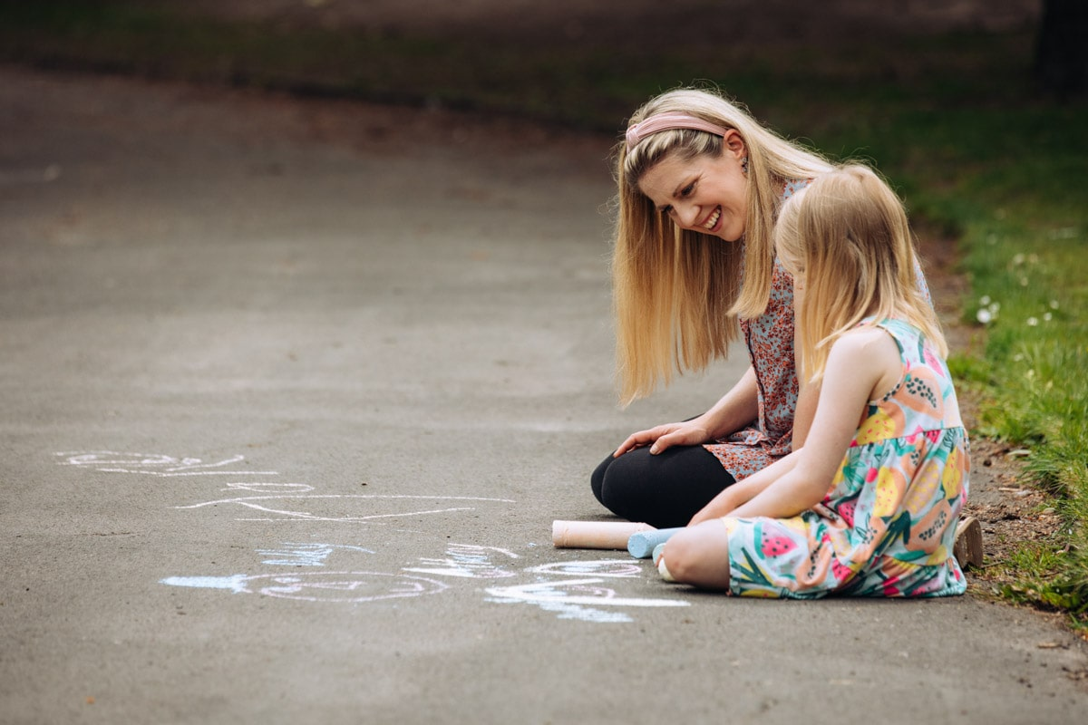 Mum and daughter drawing with chalk