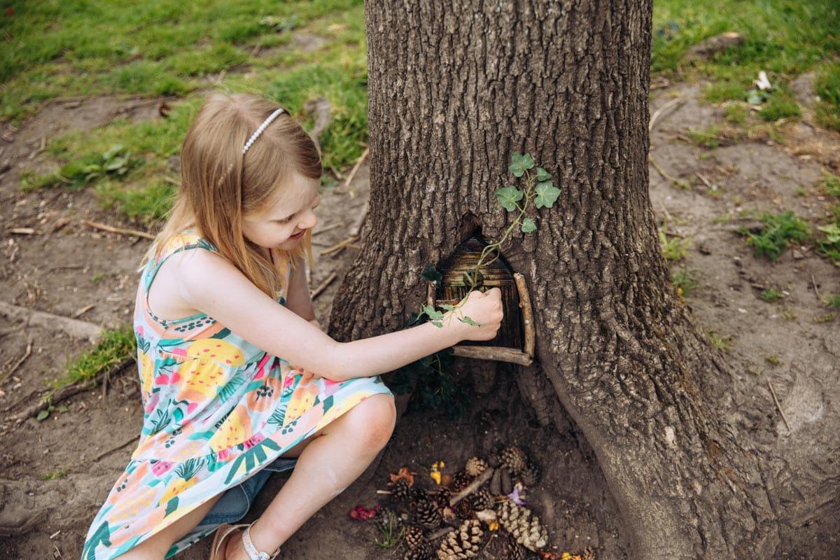 Girl finds magical door in tree