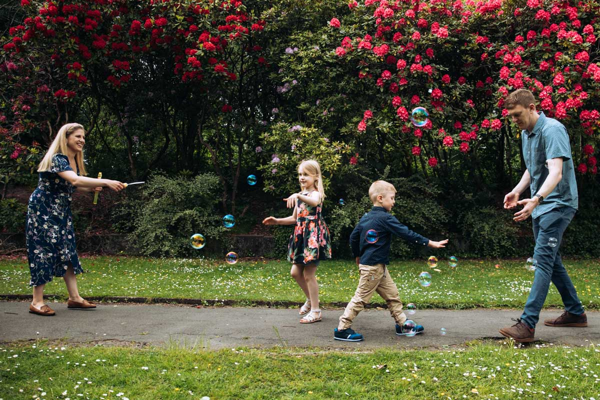 Family playing with bubbles
