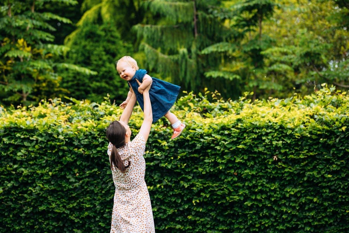 Mum throws daughter in air