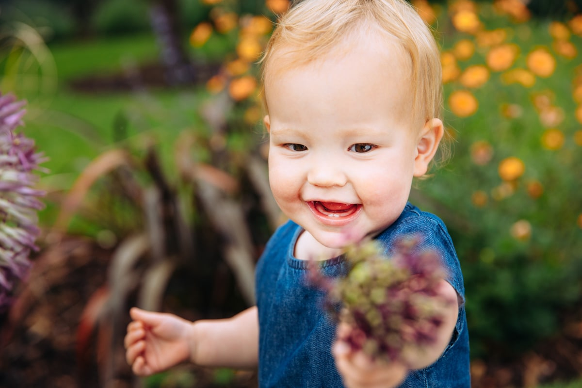 Baby holding flower