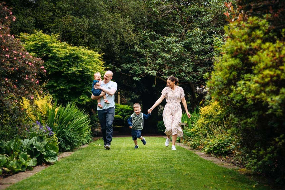 Family running in gardens