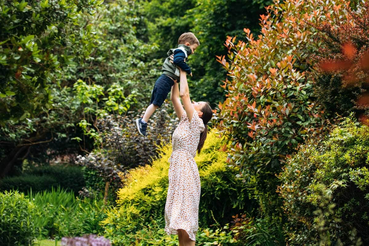Mum throws son in air